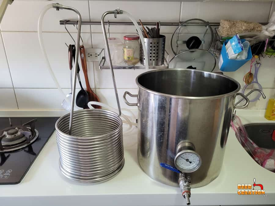 picture of a immersion wort chiller and brew kettle on a worktop